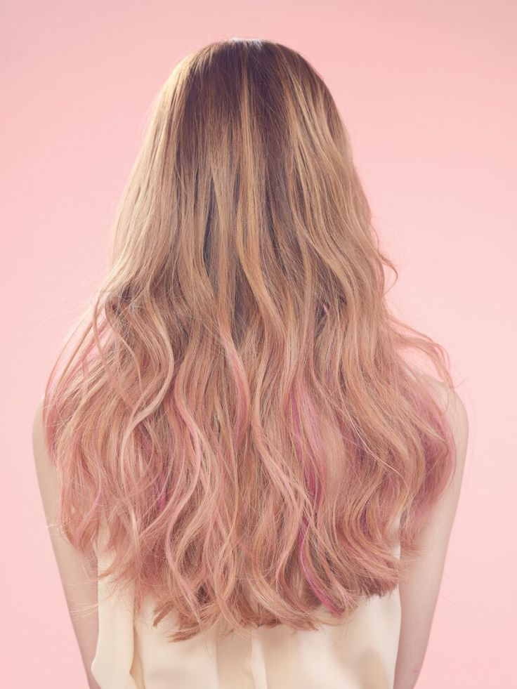 Blonde highlights with a hint of pink. Pink dip dye. Pink tips.