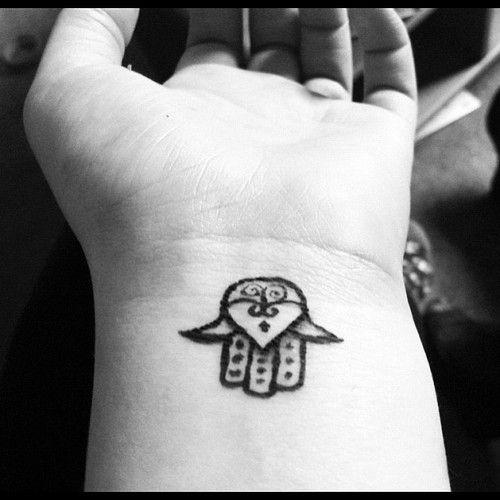 Hamsa tattoo with black ink