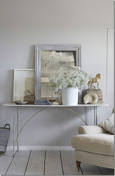 A lovely arrangement in white & beige . . . maybe use an old wooden ironing board . . .