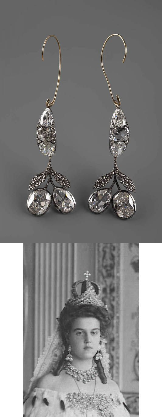 The diamond earrings were once belonged to Catherine II (r. 1762-1796). Shaped of the cerries set with diamonds. The heavy earrings are hooked on ears. These were traditionally worn by all Romanov brides along with the Romanov nuptial crown and another whopper tiara. The ohoto is Grand Duchess Maria Pavlovna of Russia as a young bride in 1908.
