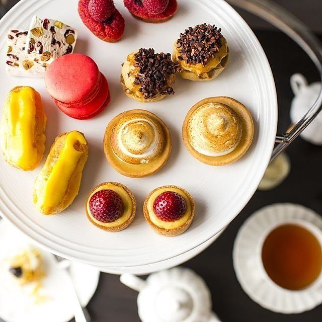 """Oh yum, High Tea!"" Perched on the rooftop of the @burburyhotel, the Terrace overlooks the city, lake and leafy streets of Barton making it a picturesque spot for indulging in high tea. Expect a selection of finely made French cakes and tarts, delicate savouries and traditional scones. #visitcanberra"