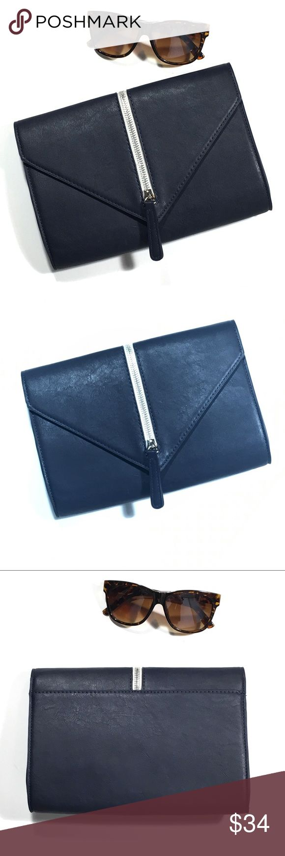 "New Navy Blue Envelope Clutch with Exposed Zipper Awesome navy Clutch has magnetic snap closure and one interior zip pocket. 10"" x 7"" tall. It's a very dark navy blue with silver zipper. Man made materials. It is new with tags and has a minor scratch as seen in 5th pic. Bags Clutches & Wristlets"