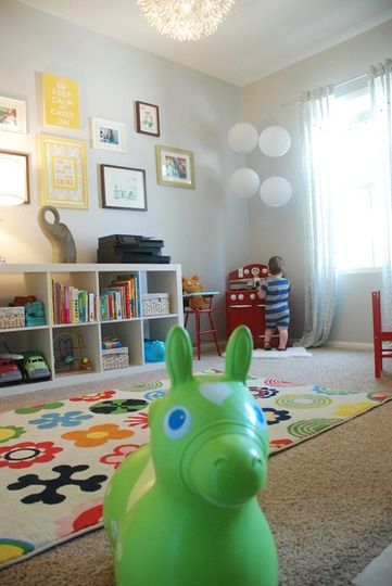 Cute playroom! Colorful rug, fun prints... just what I have in mind.