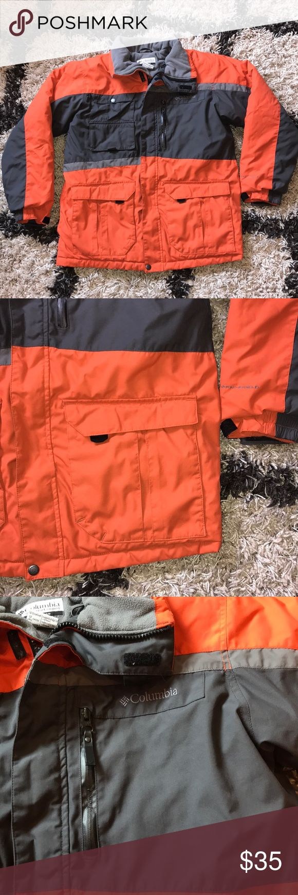 Boys Columbia Water Resistant Coat Size 14/16 boys. Water resistant exterior. Headphone ready interior pocket. Mesh interior pocket. 3 exterior pockets and one flap pocket for ID or ski pass. Orange and gray. Columbia Jackets & Coats
