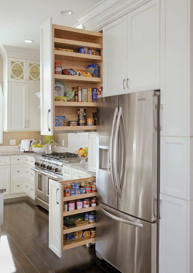 A KitchenAid Refrigerator Is Tucked Into This White Cabinetry