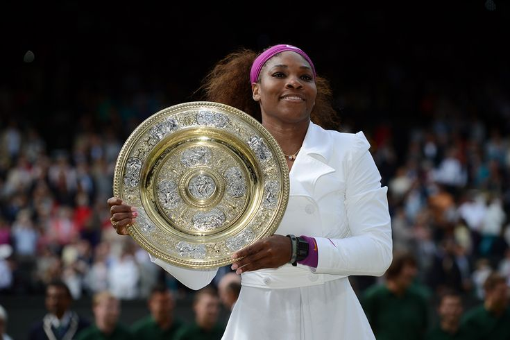 Serena Williams poses with the Venus Rosewater Dish after winning her fifth Wimbledon Championship. - Matthias Hangst/AELTC