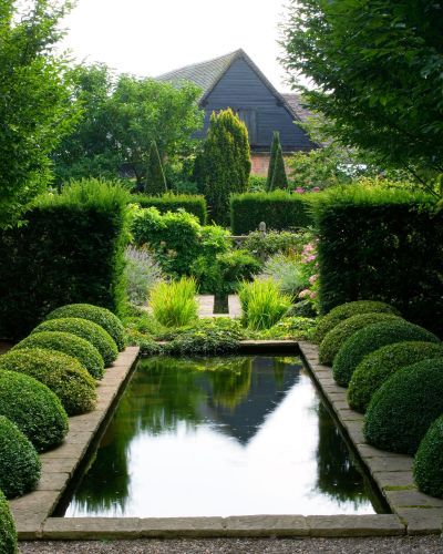 At Wollerton Old Hall gardens a simple rectangular reflective pool edged attractively with semi-circular box balls - nothing further needed.