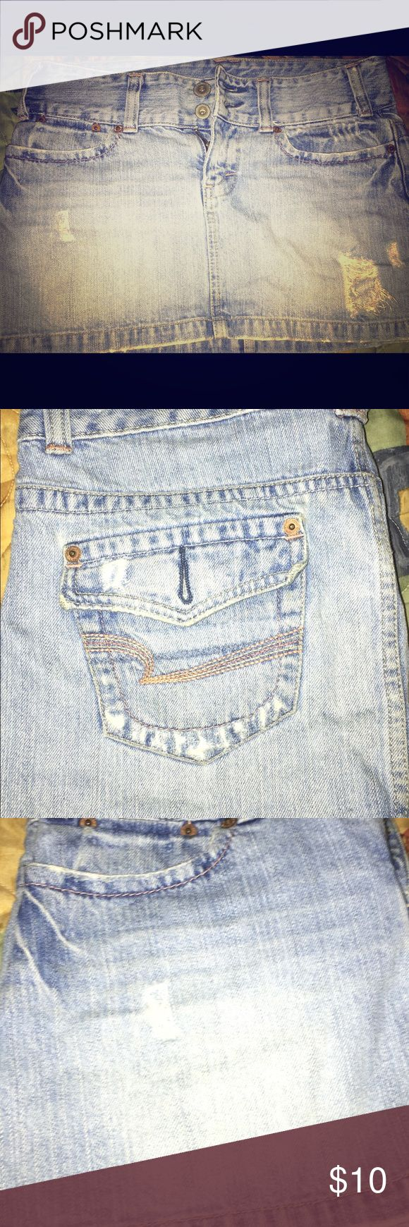 Gently Used American Eagle Skirt ✨🌈🌻 Gently used light denim American Eagle 🦅 skirt , perfect for the upcoming warm weather. This is one of my favorite skirts and items in my closet 💖💖. It's about mid thigh length, so show them legs 😎😍! Missing a back pocket button, but other than that great condition. American Eagle Outfitters Skirts Mini