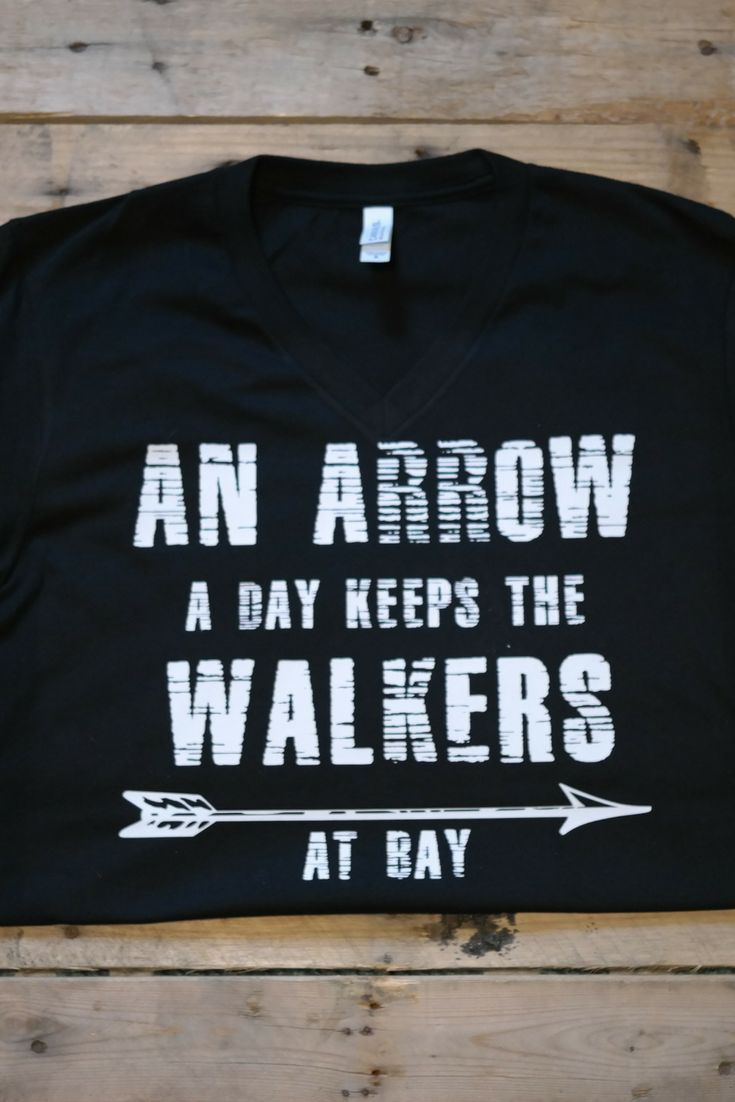 An Arrow a day keeps the walkers at bay V-Neck Tshirt  zombies, love zombies, graphic t-shirts, graphic designs, zombie shirts, TWD shirts, walking dead, Walking dead fashion,
