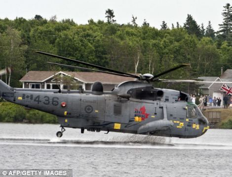 A Canadian Navy Sea King helicopter lifts off from the water, piloted by Britain's Prince William as he carries out a manoeuvre known as 'waterbirding' at Dalvey Lake in Prince Edward Island Canada