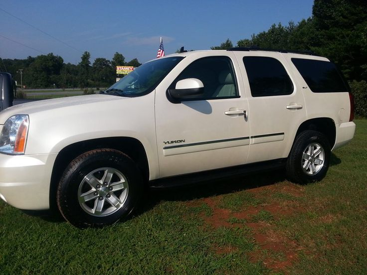 Check out this 2012 GMC Yukon SLT 2WD, white with tan leather interior only 47K miles! For more details call 828-286-2614!