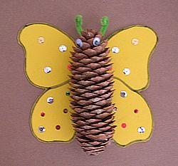 Mariposa con goma eva y una piña para niños