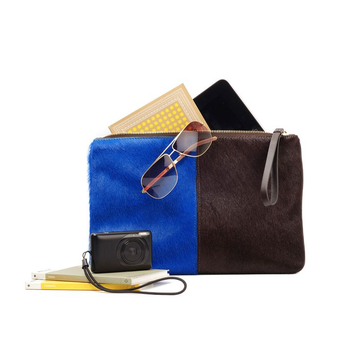 We just can't enough of our Travel Clutch Divan. It's stunning with its electric blue and chocolate brown contrast.  see more details at: www.jauntaccessories.com.