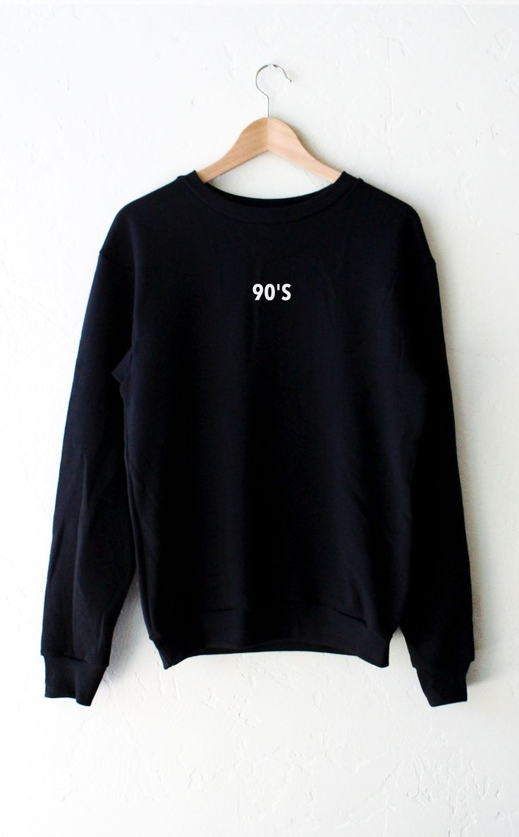 """- Description - Size Guide Details: '90's' oversized crew neck fleece sweatshirt in black by NYCT Clothing. Oversized, Unisex fit. 50% Cotton, 50% Polyester. Made in USA. Sizing: (Size Guide) 40"""" / 10"""