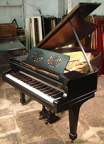 A 1915, Steinway Model O grand piano with a satin, black case.at Besbrode Pianos