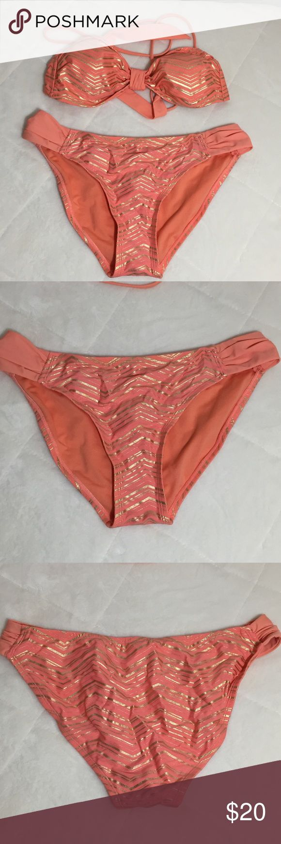Xhilaration Bikini Size L Orange and flattering gold zig zag stripes  The top as a plain band separating the lightly padded cups. Tie closure on bottom and top, making it easy to fit most cut sizes  The bottoms have a plain band holding the front and rear together. Xhilaration Swim Bikinis