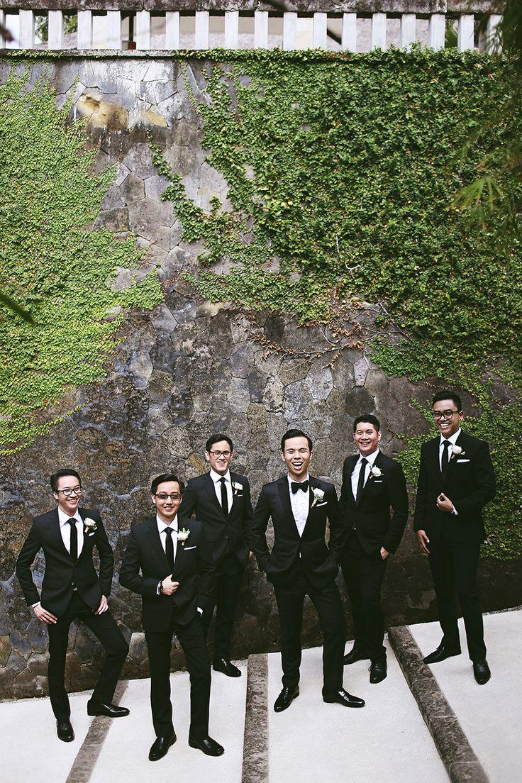 Groom and groomsmen looking smart in black // Audwin And Clarissa's Luminous Courtyard Wedding at Amanusa, Bali