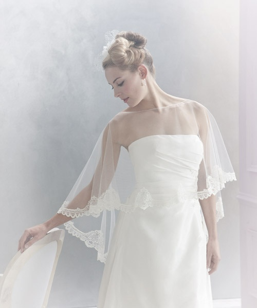 Bridal poncho. Airy tulle and lace at www.konstantinostsigaros.gr