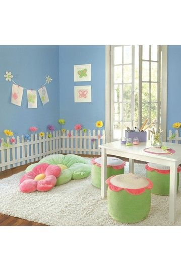 LOVE this playroom for a little girl! Too bad I don't think Blake would appreciate it very much if I exchanged his desire for a superhero play with with a nice white picket fence and flowers along the walls. Darn!