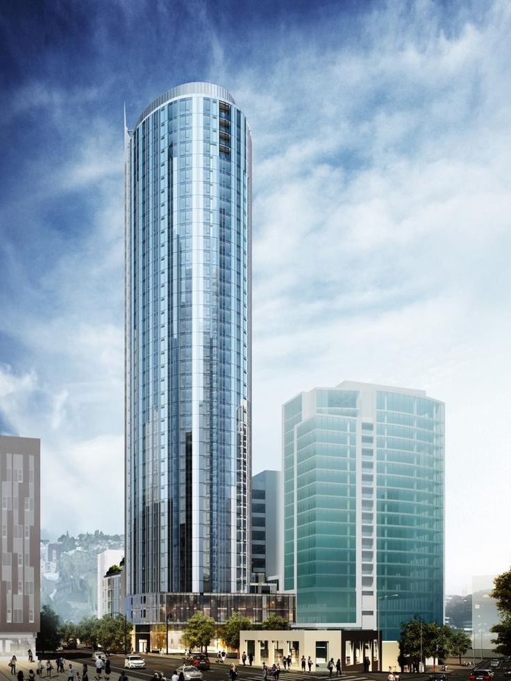 Under Way Luxury Apartment Tower Rises From Parking Lot