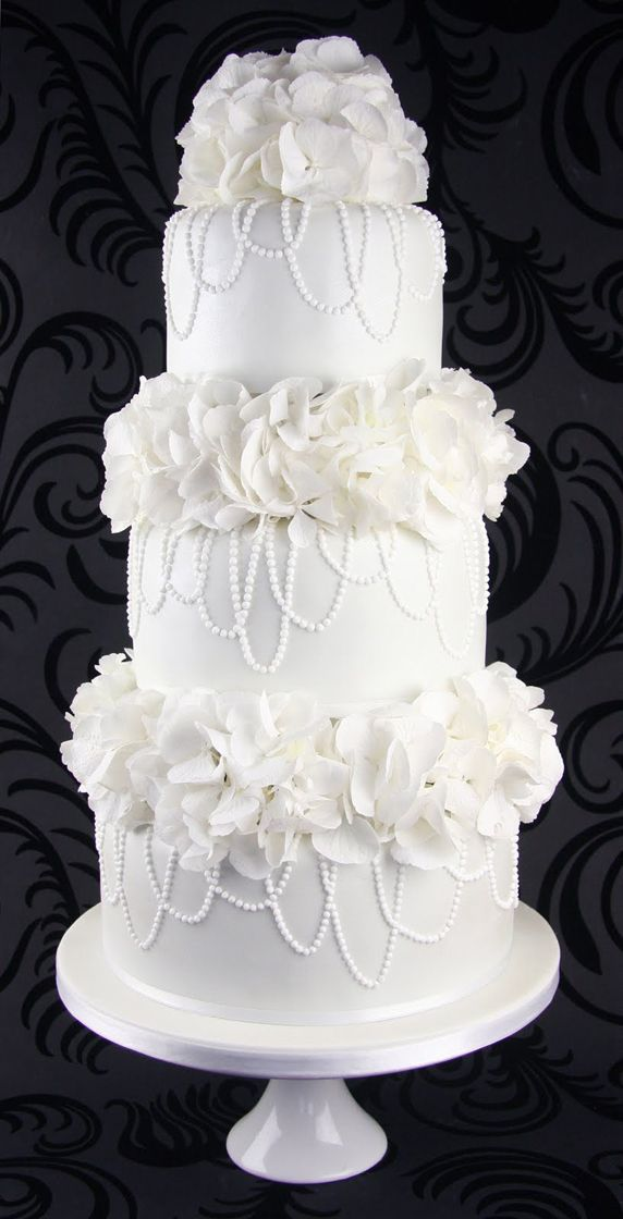 Elegant white wedding cake with flowers and pearls - For all your cake decorating supplies, please visit craftcompany.co.uk