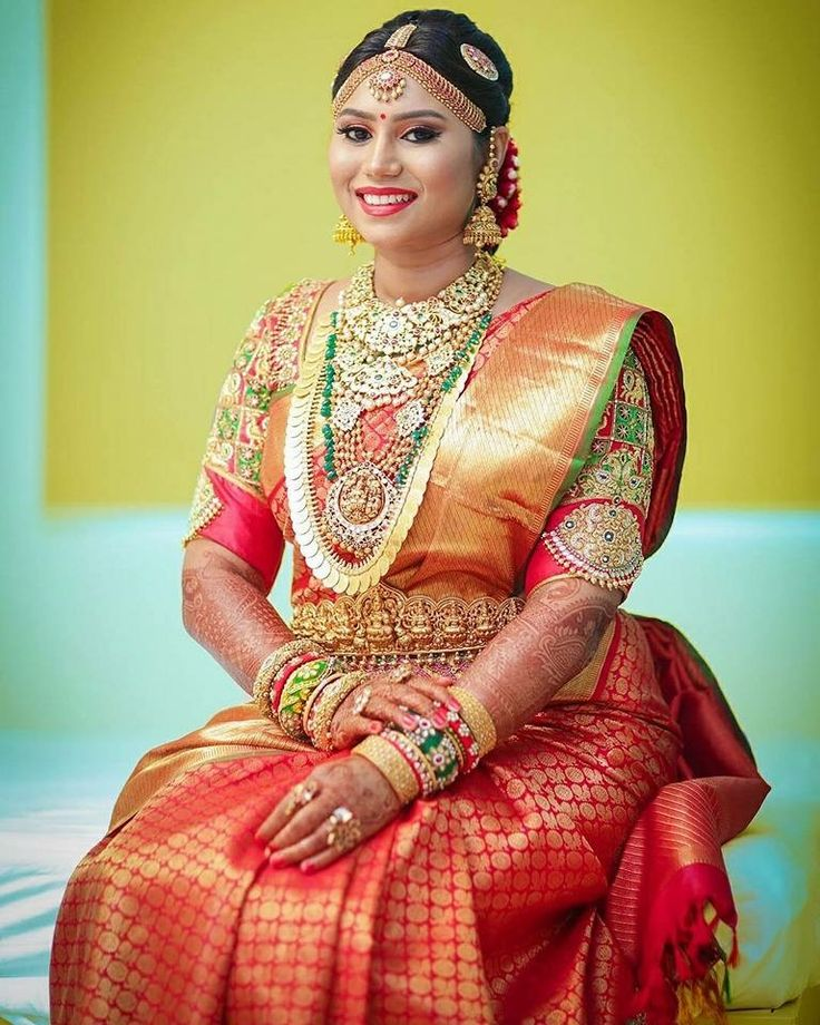 South Indian bride. Gold Indian bridal jewelry.Temple jewelry. Jhumkis.Red silk kanchipuram sari with contrast green blouse.braid with fresh jasmine flowers. Tamil bride. Telugu bride. Kannada bride. Hindu bride. Malayalee bride.Kerala bride.South Indian wedding.