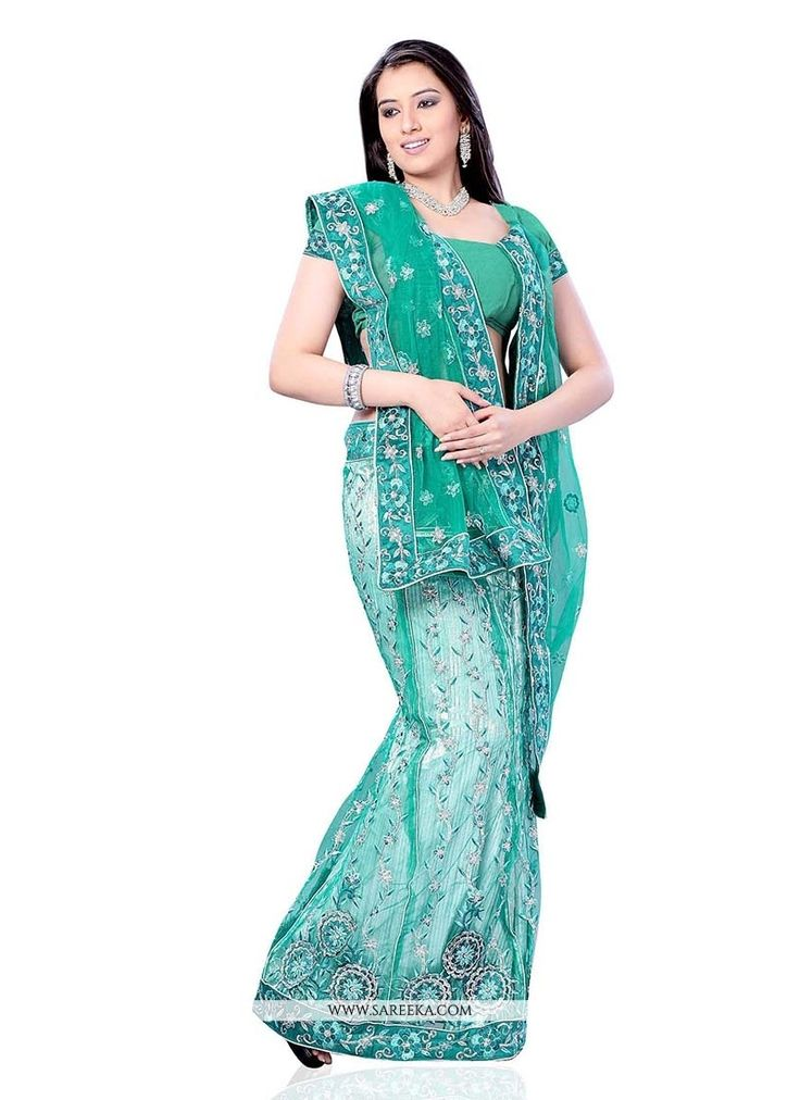You can be confident to make a powerful style statement with this sea green net lehenga saree. This wonderful attire is showing some unbelievable embroidery done with embroidered and patch border work...