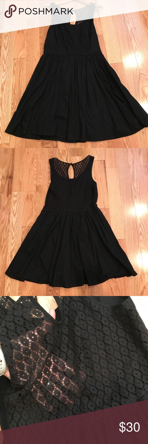 Lace back black flown sundress Lace back black flown sundress. Size Med/Large.  Back had no lining so you can see through the lace but the skirt is lined. Side zipper. Dresses