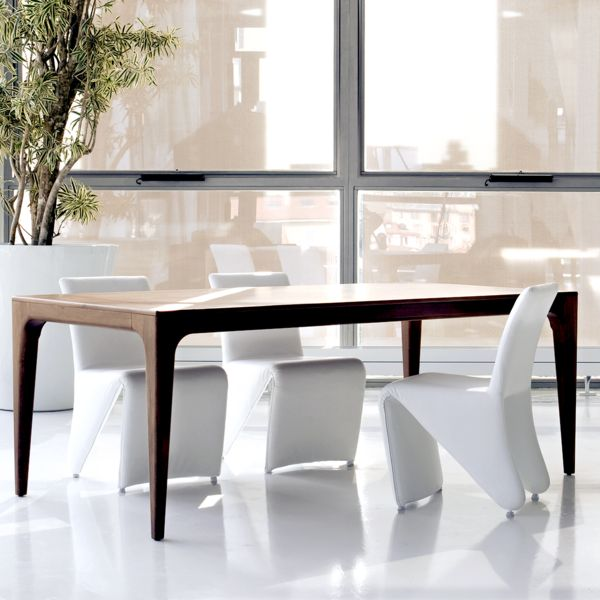The extendable Fashion dining table by Italy's Pacini e Capellini has a timelessly chic feel that will complement both modern and classic homes. Fashion has a solid ash base with an ash veneer top, and comes in a selection of stained wood and lacquer finishes.