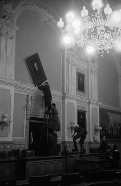 Hungarian revolution. In the council room of the city hall. In order to calm the insurrection crowd outside, the portrait of Lenin in the city hall is rapidly being removed by insurgent soldiers, Gyor, ca. 1956.