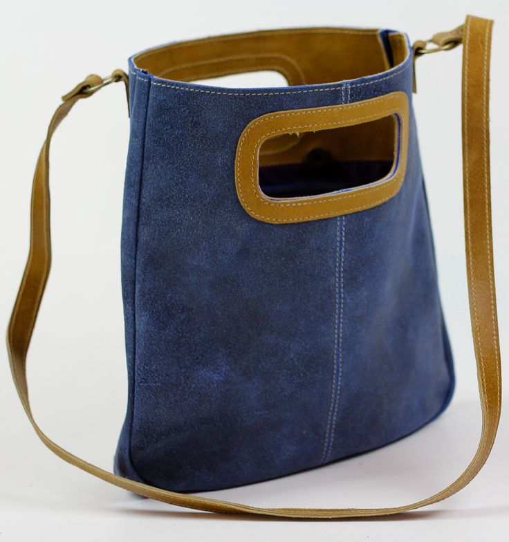 """PRODUCT INFO      This vintage style genuine leather handbag features:          * Magnetic Closure         * Handmade         * Dimensions Length 11.81"""" Width 1.18"""" Height: 11.6""""         * 1 Inside zipper compartment and 2 open pouches         * Single Strap (20"""" to midpoint)      Bag for every day use, carry your tablet, wallet, keys, make up and other like items."""