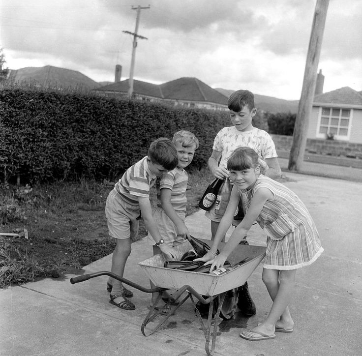 Sharing Molony children and wheelbarrow, collecting bottles. [P1-5166-7556] at Upper Hutt City Library