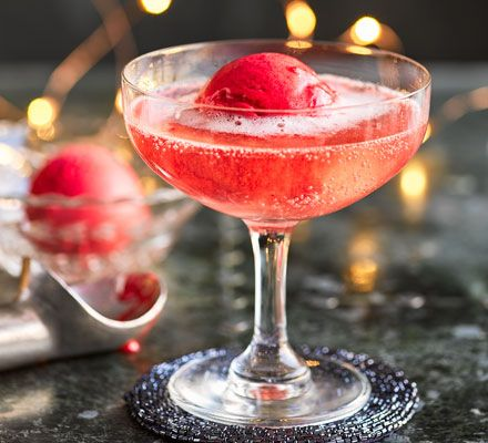 For a twist on a classic sgroppino cocktail, we've added a scoop of refreshing berry sorbet, making this iced Christmas tipple extra special