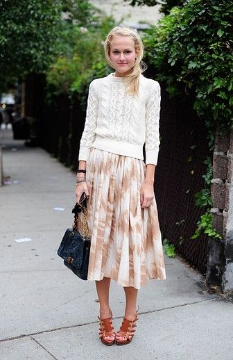 The perfect way to start mixing spring pieces into your wardrobe: Pairing floral midi skirt and sandals with a shrunken cable-knit sweater.