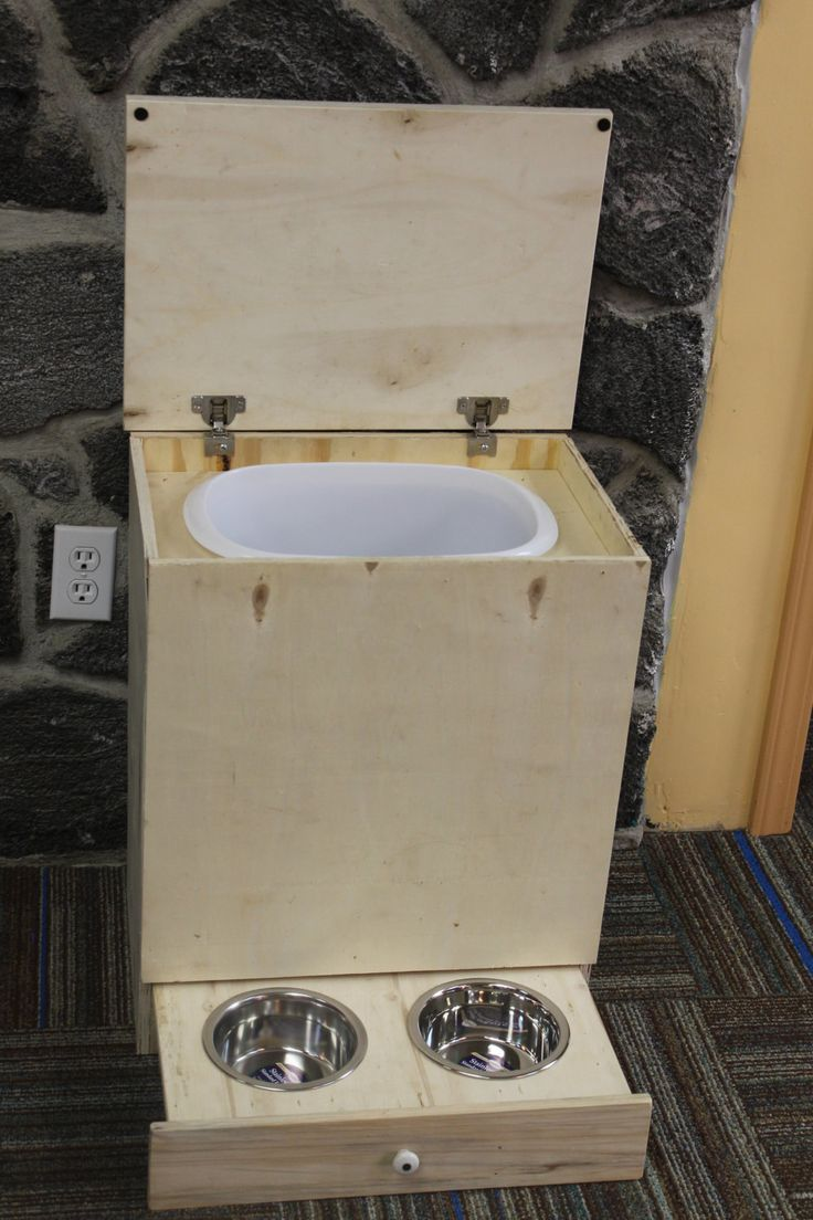 """Handcrafted Dog Food Bin and Feeder Small-19""""x23"""" (Unfinished). $39.99, via Etsy."""