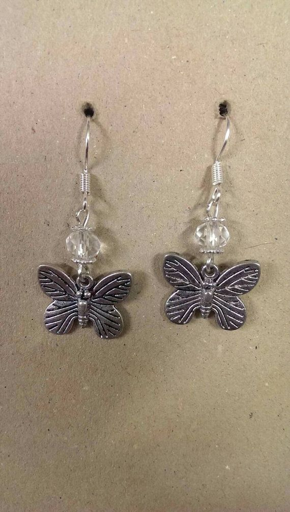 Clear faceted earrings with butterfly charm. by KinleysDesigns