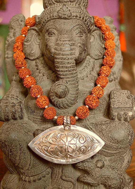 "Indian Amulet Rudraksha Necklace. India silver pendant: 6.6cm x 4.2cm. Rudraksha beads: 1cm. Length 19"" (48.5cm) long."