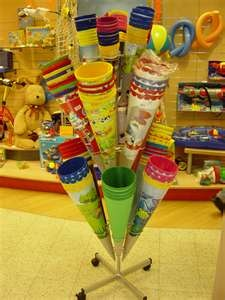 "A ""Schultüte"" is a paper (and later plastic) cone. When children in Germany and Austria set off for their first day in school upon entering first grade, their parents and/or grandparents present them with a big cardboard cone, prettily decorated and filled with toys, chocolate, candies, school supplies, and various other goodies. It is given to children to make this anxiously awaited first day of school a little bit sweeter."