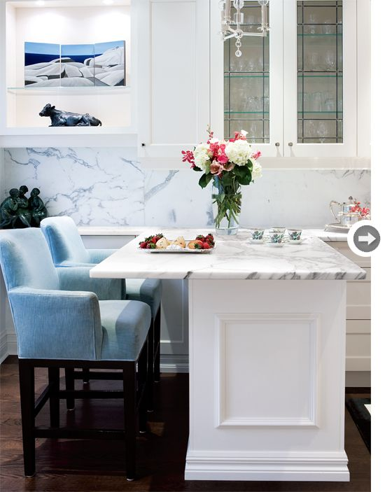 love the blue chairs countertop. A one-level breakfast bar easily doubles as a prep station. Access from both sides reduces crowding in the kitchen and provides more work surface.