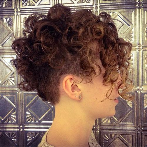 An undercut works so well with #shortcurlyhair.