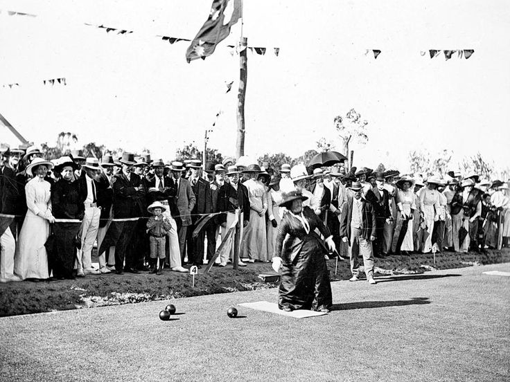 The opening of the Warracknabeal Bowling Green in 1909. Crowds watch as a woman sends down the first bowl.