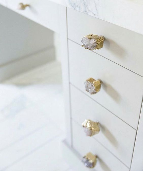 Glue river rocks to plain cheap wooden knobs for bathroom hardware