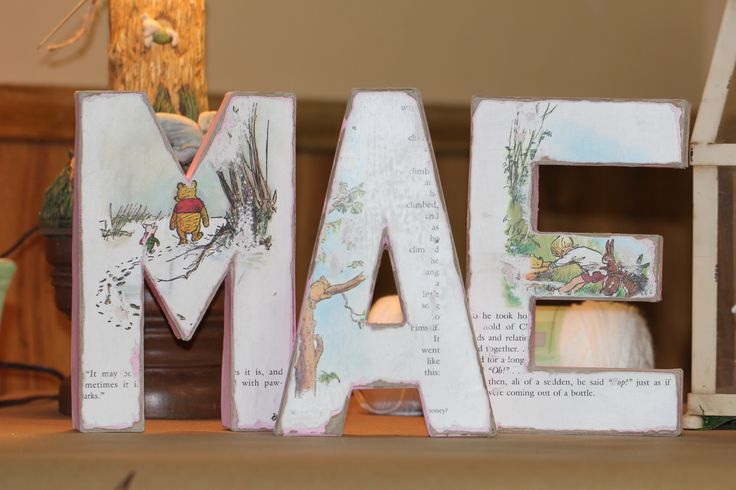 I used this as a decoration, but also a gift for Mom, baby's name on block cardboard letters from Hobby Lobby, I used mod podge to adhere the book pages, then after that dried, sanded them.