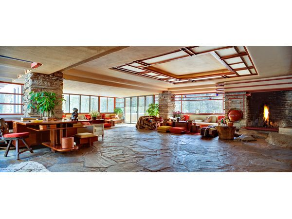 """Fallingwater (interior) with huge red """"tea kettle."""" stone carved in hearth to make room for kettle. #light #space #flw The home also features original art by Picasso and Rivera"""