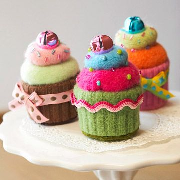 felt cupcake ornaments? By far the cutest and most difficult ones i've found. @Sara S and @Shelagh Fallon, when is felted-craft night, ladies?