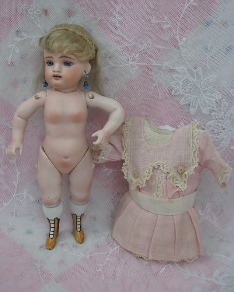 "Antique All Bisque Kestner ""The Wrestler"" with Factory Dress Dolls And Lace.com"