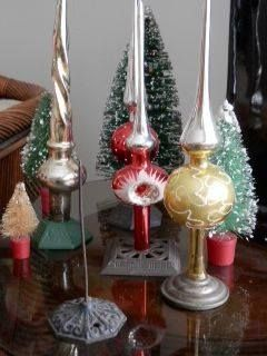 Receipt spikes used to turn vintage tree toppers into centerpieces!