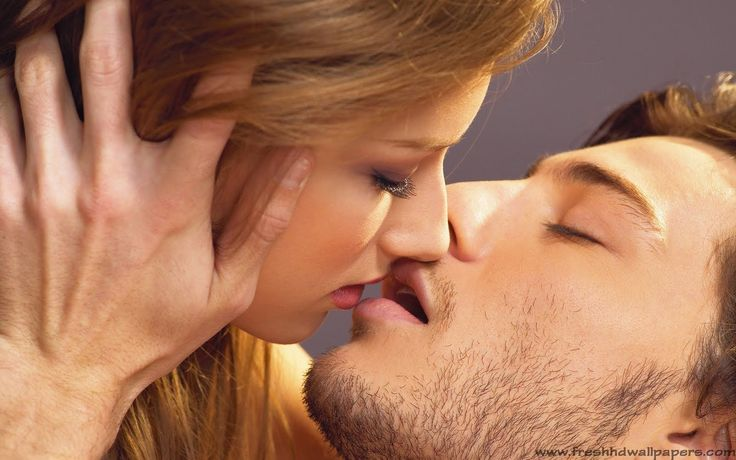 Woman Man In A Kissing The Lips A