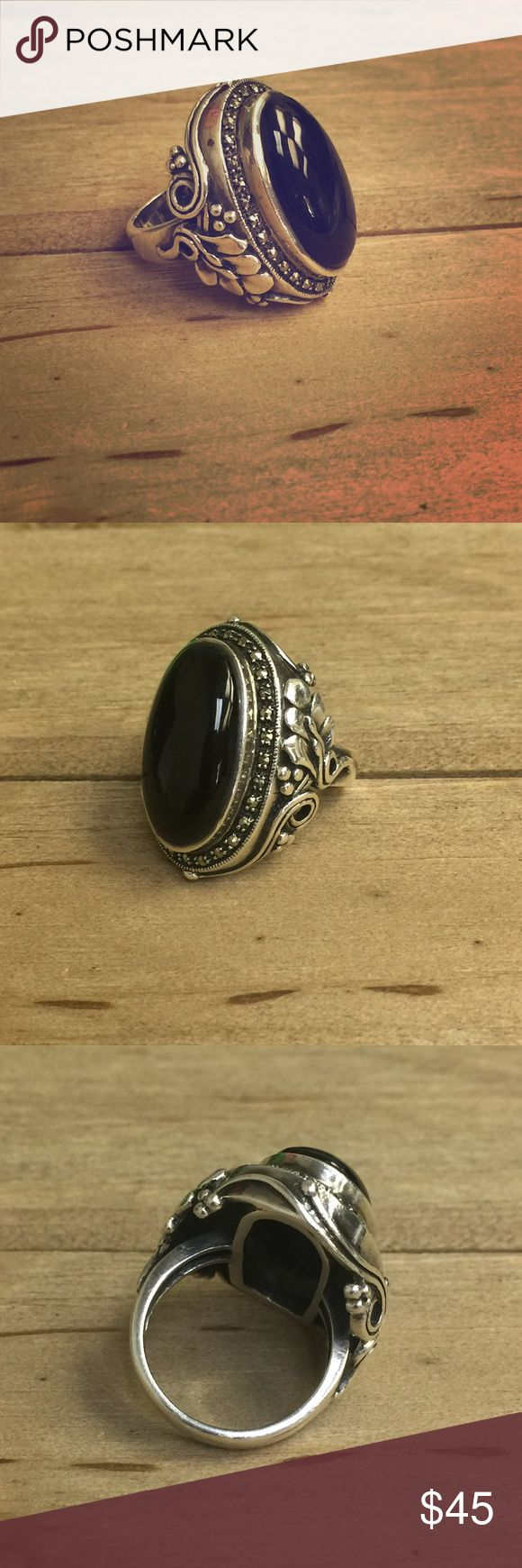black onyx marcasite sterling chunky ring size 8. all marcasite stones are intact and center onyx stone is in pristine condition. little to no wear on band. great floral detail on the side. large but very comfortable ring. Jewelry Rings