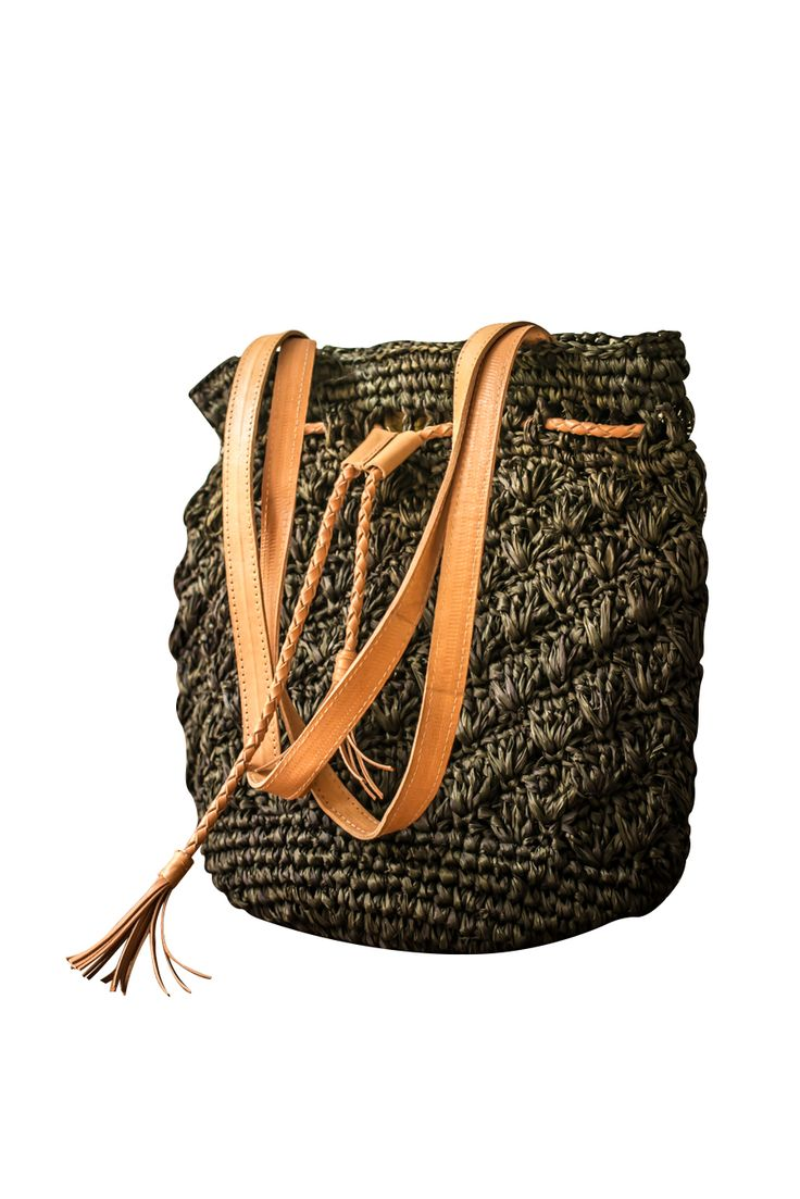 Black palm leaf bag with leather straps. Contact info@sawo-design.com for more details and whole sale prices.